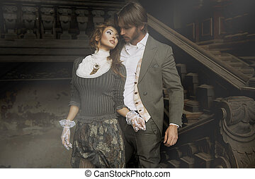 Young couple in an old house