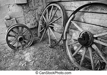 Old wooden wheels of cart. - Old wooden wheels of cart at a...