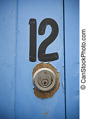 Number 12 - The number twelve painted on a boat shed door