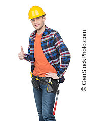 Handyman Confident young handymen in hardhat holding thumb...