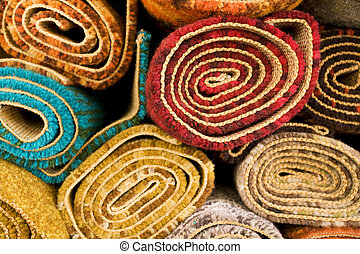 Colored Rugs - Section detail of a pile of colorful rugs