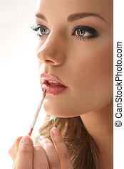 woman with lip gloss - Girl lipstick on a white background