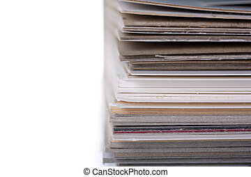 separating stacked sheets to organize a folder with white...