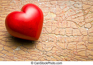red stone heart on old cracked background