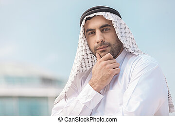 Thoughtful Arab businessman Confident Arab businessman...