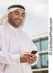 Arab businessman with mobile phone Confident Arab...