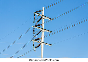 High power electricity post on blue sky background