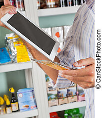 Man With Digital Tablet And Product In Supermarket -...