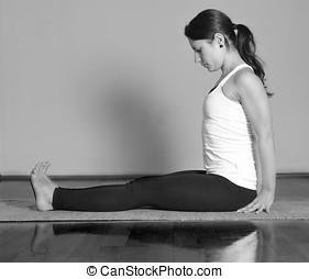 Girl doing Dandasana yoga pose - Marichyasana A