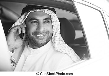 Cheerful Arab businessman Black and white image of smiling...