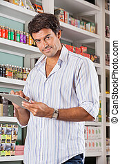 Handsome Man With Tablet In Supermarket