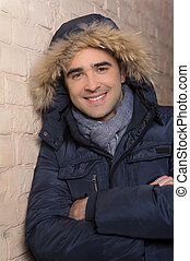Man in winter clothing. Cheerful middle-aged man in winter...