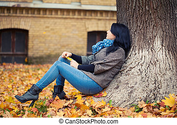 Young pretty woman in autumn park