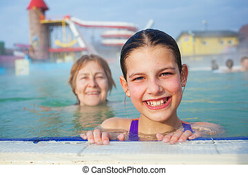 Activities on the pool. Portrait of cute girl with...