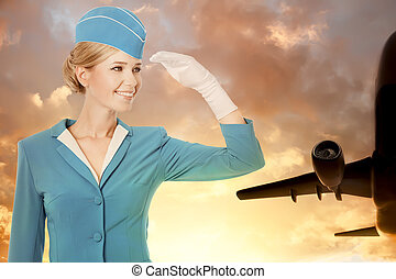Charming Stewardess Dressed In Blue Uniform On Sky...