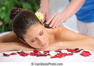 Beautiful Woman Getting Hot Rock Spa Therapy