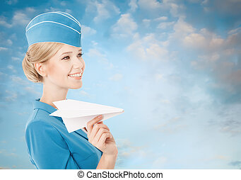 Charming Stewardess Holding Paper Plane In Hand. Blue Sky...