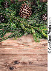 christmas tree branches with bumps on wooden background