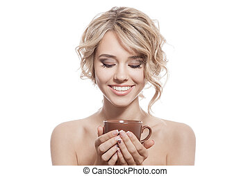 Young happy woman with an aromatic coffee in hands. Isolated