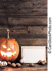 halloween background with sheet of paper and decoration