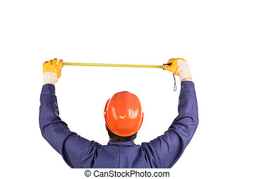 Worker in hard hat measure with ruler