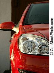 Red modren car - Close-up of a new modern car head lamp