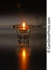 Lone Candle - A single tea light type candle in a glass...