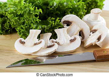 Button mushrooms - Pieces of champignons in the kitchen