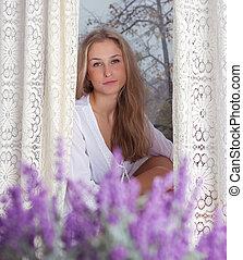 woman enjoying her morning near window - young beautiful...