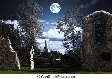 Full moon over an angel statue