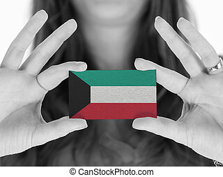 Woman showing a business card, black and white, Kuwait