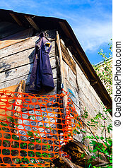 Vest hanging on a wooden barn - Safety barrier lattice...