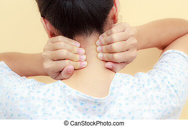 Woman holds a hand on neck pain - Woman holds a hand on neck...
