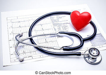 Stethoscope lying on ECG diagram - Stethoscope with a red...