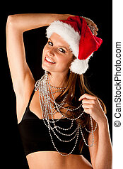 Beautiful young woman in red santa dress isolated over black background