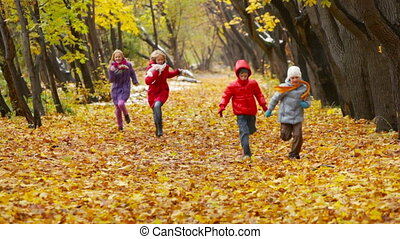 Cheerful Childhood - Cheerful children running energetically...