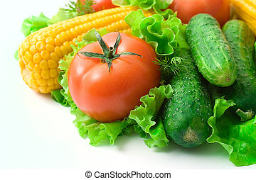 Vegetables: tomatoes, cucumbers and corn Vivid healthy...