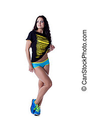 Attractive slim brunette posing in sportswear