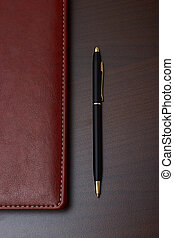 Business style: daily with leather cover and a black pen