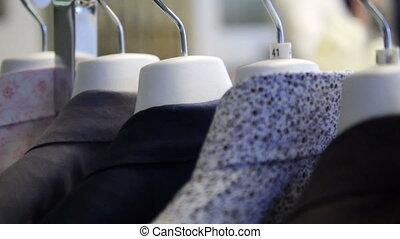 siuts in fashion boutique - HD 1080p - pan through a...