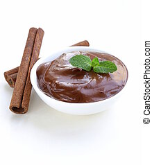 chocolate spread with cinnamon sticks on a white background