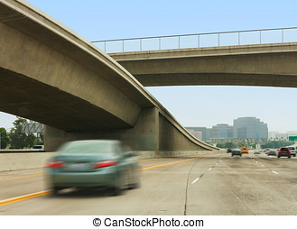 Freeway interchange, overpass, and fast cars - Concrete...
