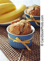 Banana muffins in ceramic baking mold with yellow ribbon...
