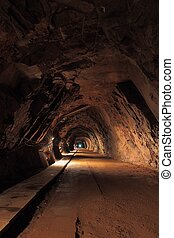 Mine tunnel - Long and dark tunnel in old uranium mine