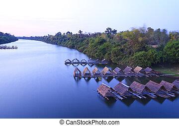 Mun river with raft restaurant in Sisaket province, Thailand