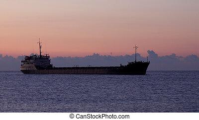 cargo ship at sunrise