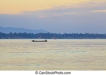 Fishing boats in the Mekong River at sunrise