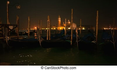 Venetian gondolas tied near the pier on San Marco square,...