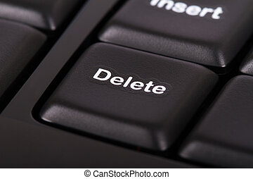 Delete Key - Delete key on black computer keyboard.