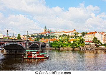 Tourist the ship floats under Charles bridge, Prague, Czech...